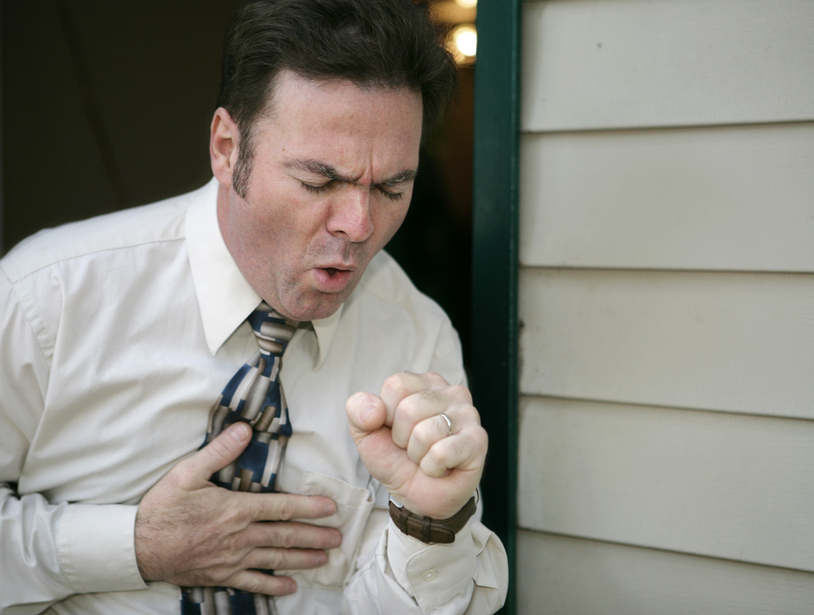 A man leaving work early because of a coughing fit.
